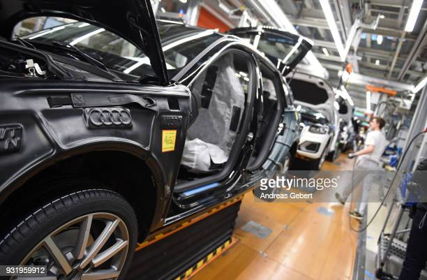 Workers assemble Audi sedans on an assembly line at the Audi automobile plant on March 14 2018 in Ingolstadt Germany US President Donald Trump has...