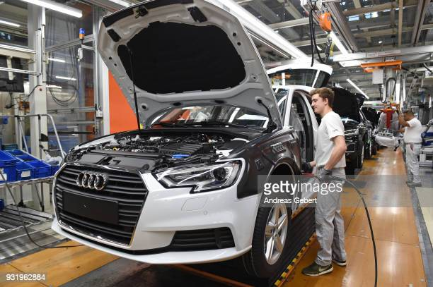 Workers assemble Audi sedans on an assembly line at the Audi automobile plant on March 14, 2018 in Ingolstadt, Germany. U.S. President Donald Trump...