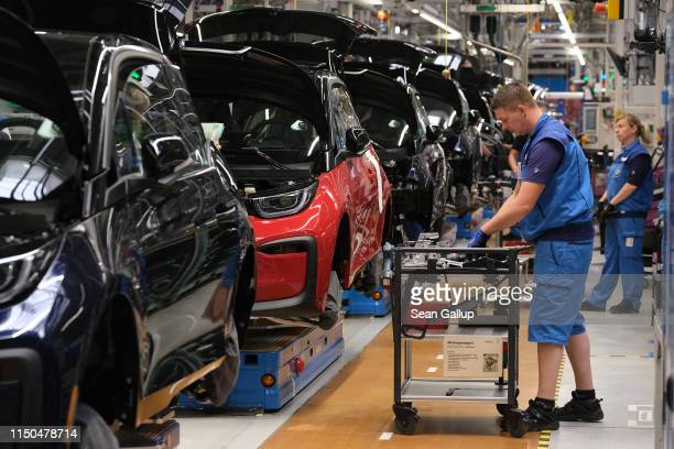 Workers assemble BMW I3 electric cars on the assembly line at the BMW factory on May 20, 2019 in Leipzig, Germany. German President Frank-Walter...