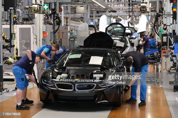 Workers assemble BMW I8 hybrid cars on the assembly line at the BMW factory on May 20 2019 in Leipzig Germany German President FrankWalter Steinmeier...