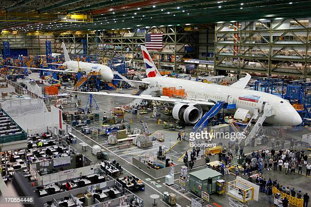 Workers assemble Boeing Co 787 Dreamliner airplanes at the Boeing Everett Factory in Everett Washington US on Wednesday May 29 2013 Boeing Co...