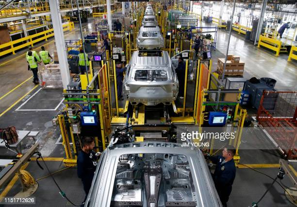 Workers assemble cars at the newly renovated Ford's Assembly Plant in Chicago June 24 2019 The plant was revamped to build the Ford Explorer Police...