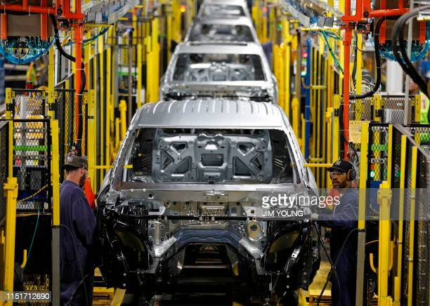 Workers assemble cars at the newly renovated Ford's Assembly Plant in Chicago, June 24, 2019. - The plant was revamped to build the Ford Explorer,...