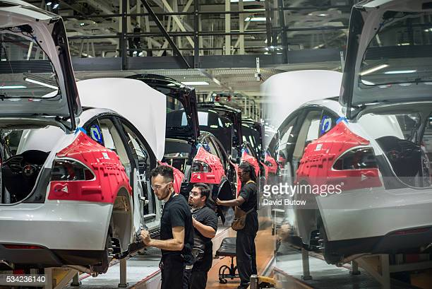 Workers assemble cars on the line at Tesla's factory in Fremont David Butow