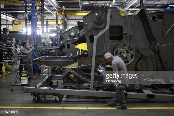 Workers assemble combine harvesters at the CLAAS of America Inc production facility in Omaha Nebraska US on Wednesday June 6 2018 The Federal Reserve...