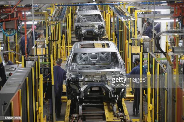 Workers assemble Ford vehicles at the Chicago Assembly Plant on June 24, 2019 in Chicago, Illinois. Ford recently invested $1 billion to upgrade the...
