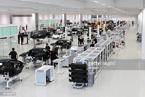 Workers assemble high performance McLaren MP412C sports cars in the Production Centre of the McLaren Technology Centre on November 17 2011 in Woking...
