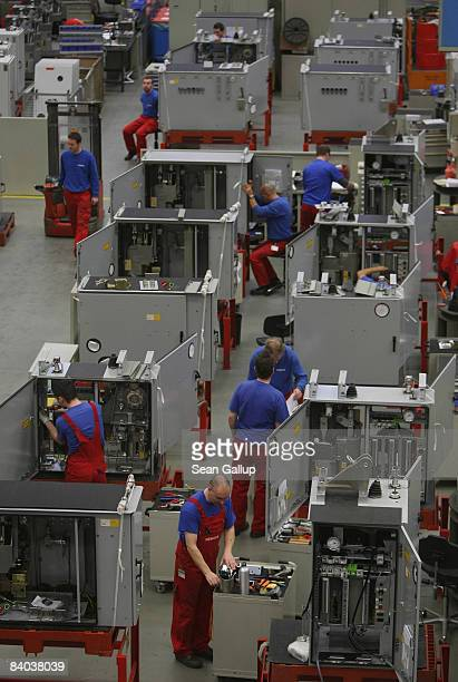 Workers assemble highvoltage circuit breakers at a factory of German engineering company Siemens on December 15 2008 in Berlin Germany The world...
