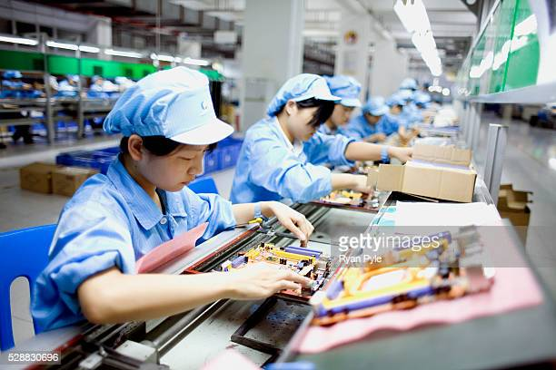 Workers assemble laptop computer on the assembly line at Hasee Computer company's manufacturing center in Shenzhen Guangdong China Hasee Computer...