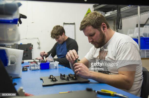 Workers assemble parts during production of LulzBot 3D printers at the Aleph Objects Inc facility in Loveland Colorado US on Wednesday March 14 2018...