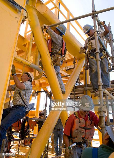 Workers assemble scaffolding on the Independence Hub gas production platform which is under construction at Kiewit Offshore Services in Ingleside,...