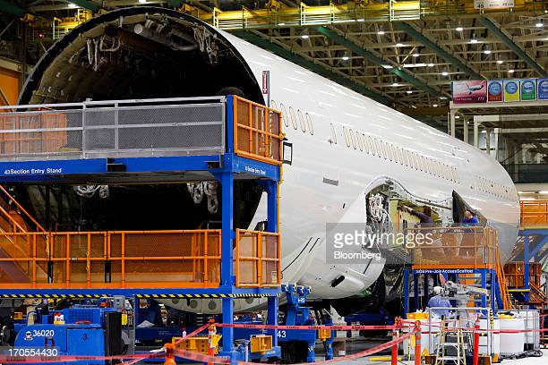 Workers assemble the first Boeing Co 7879 Dreamliner airplane at the Boeing Everett Factory in Everett Washington US on Wednesday May 29 2013 Boeing...