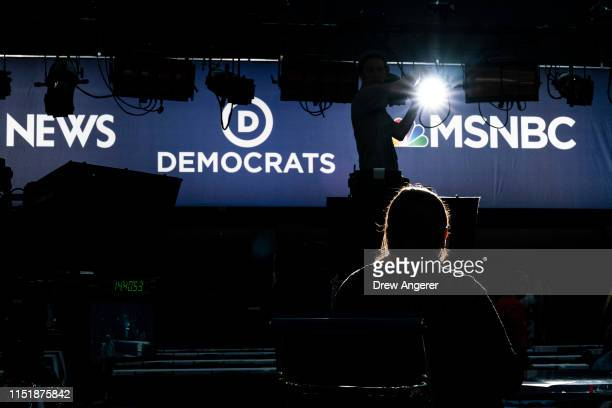 Workers assemble the television set inside the media filing center at Adrienne Arsht Center for the Performing Arts where the first Democratic...