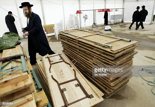 Workers assemble trescle tables February 20 2004 in London as a community of Hasidic Jews prepare for a gathering on their holy day of Shabbas The...