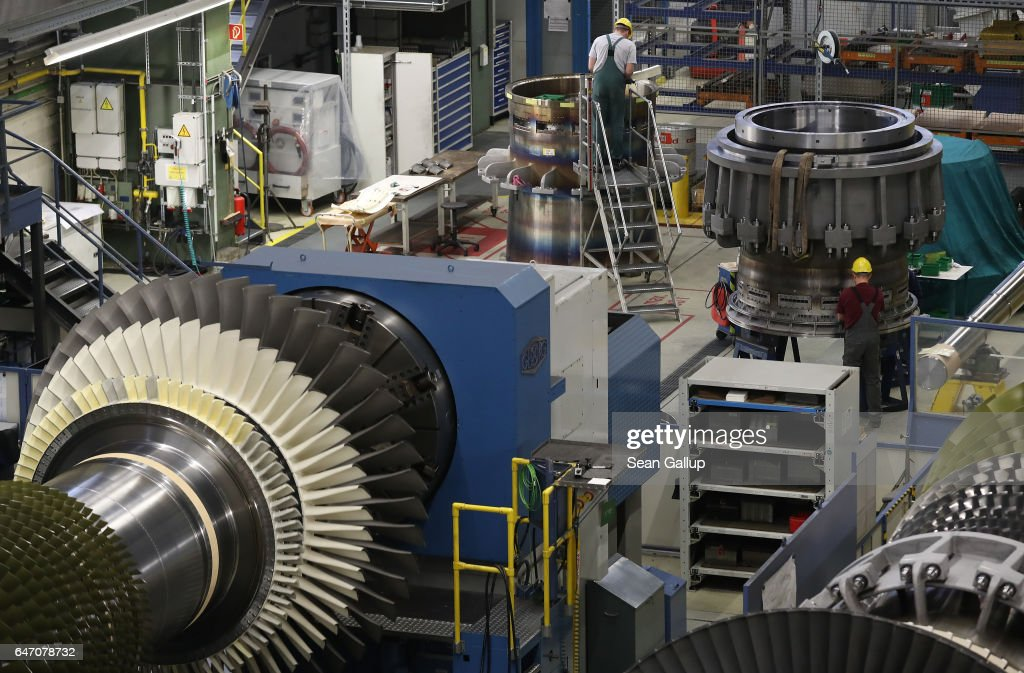 Workers assemble turbine components at the Siemens gas