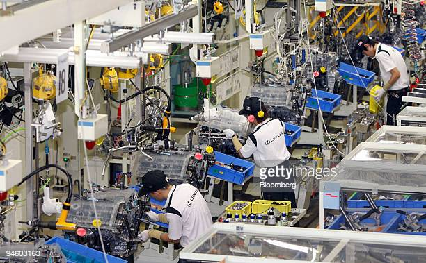 Workers assemble V8 engines of Toyota Motor Corp's luxury series Lexus LS600 hybrid sedan on the production line at its Tahara plant in Tahara...