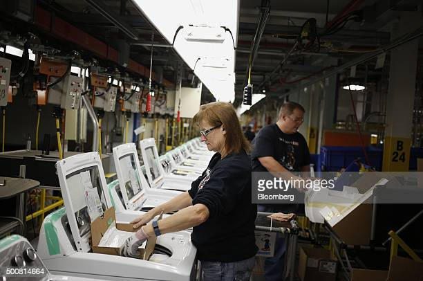 Workers assemble washing machines at the Whirlpool Corp. Manufacturing facility in Clyde, Ohio, U.S., on Wednesday, Dec. 9, 2015. The U.S. Census...
