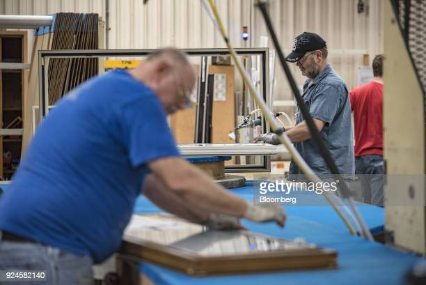 Workers assemble window frames at the Pella Corp manufacturing facility in Pella Iowa US on Thursday Feb 22 2018 The US Census Bureau is scheduled to...