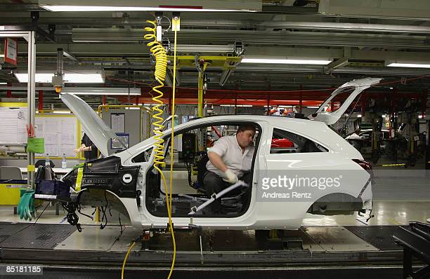 Workers assembling an Opel Corsa car at the plant of car maker Opel on March 2 2009 in Eisenach Germany Opel announces a business plan directed to...