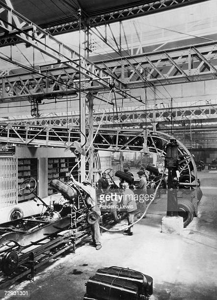 Workers assembling body work on a production line in a car plant in France late 1940s