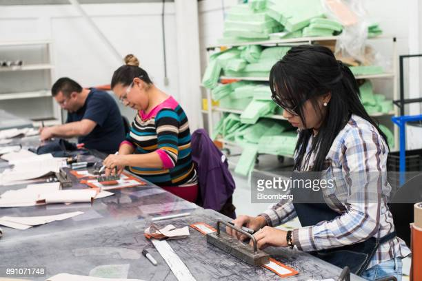 Workers assembly aircraft heat shields at the Tighitco Inc manufacturing facility in San Luis Potosi Mexico on Thursday Nov 16 2017 With 312...