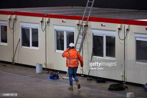 Workers assigned by Safety Region RotterdamRijnmond are seen building facilities for patients and their relatives who have tested positive for the...