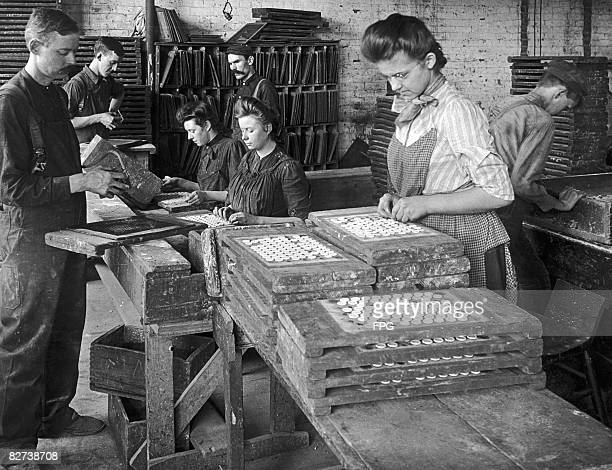 Workers at a button factory in Warsaw New York State during the Great Depression circa 1935