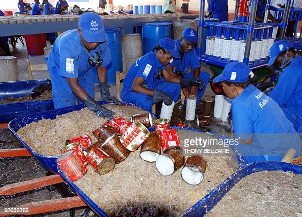 Workers at a factory on October 30 collect transformed industrial waste consisting of paper and domestic trash which is made into bricks to replace...