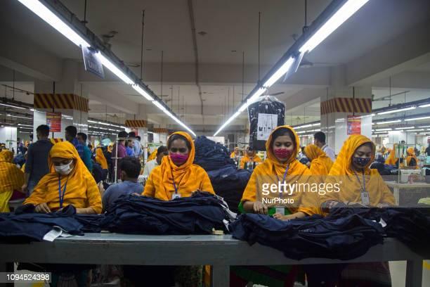 Workers at a garment factory work at MB Knit garment factory in Narayanganj near Dhaka