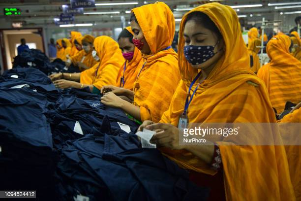 Workers at a garment factory work at MB Knit garment factory in Narayanganj, near Dhaka.