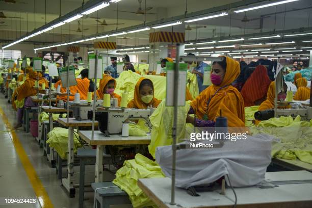 Workers at a garment factory work at MB Knit garment factory in Narayanganj near Dhaka