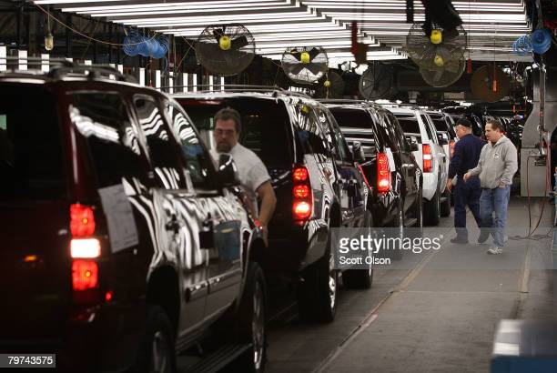 Workers at a General Motors Assembly plant make final adjustments to SUVs coming down the assembly line February 13 2008 in Janesville Wisconsin...