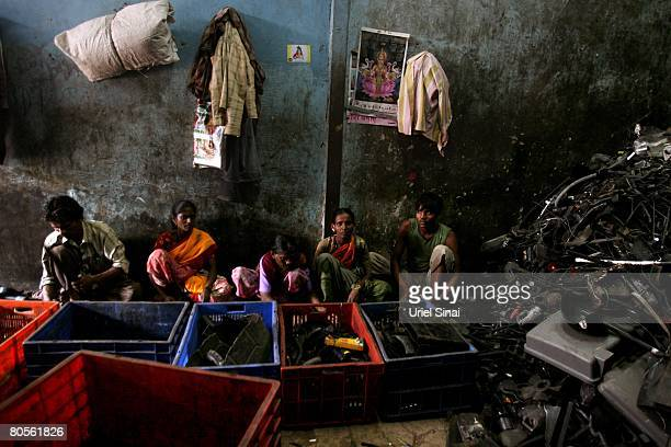 Workers at a local plastic recycling warehouse at the Dharavi slum said to be 'Asia's largest slum' April 2008 in Mumbai India A city redevelopment...
