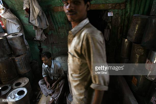 Workers at a local workshop at the Dharavi slum said to be 'Asia's largest slum' April 2008 in Mumbai India A city redevelopment program to convert...