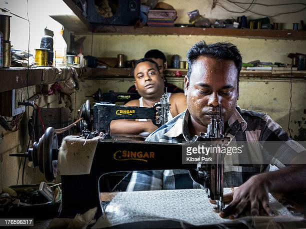 Workers at a sewing factory in Delhi: 40% work in services, 38% in agriculture and 22% in industry worldwide.