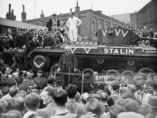 Workers at a tank factory in the Midlands attend a speech given by the Russian Ambassador Ivan M Maisky to mark the opening of Tanks for Russia Week...