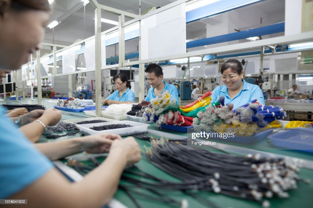 Workers at an electronics factory in Dongguan, China : Stock Photo