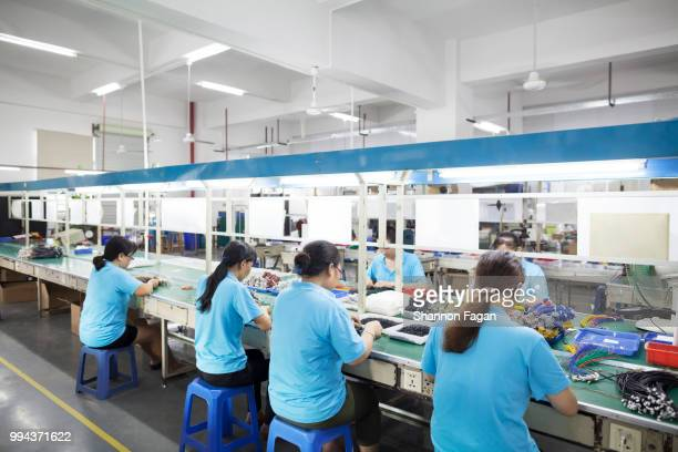 Workers at an electronics factory in Dongguan, China