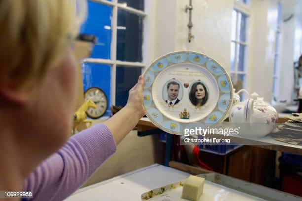 Workers at Aynsley China start producing commemorative plates, cups and mugs to mark the engagement between Britain's Prince William and Kate...
