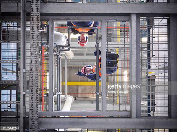 workers at biomass storage facility - monty rakusen stock photos and pictures