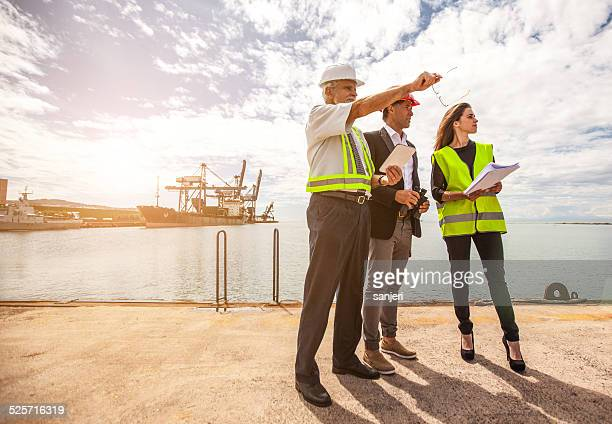 workers at commercial transport dock - commercial dock stock pictures, royalty-free photos & images