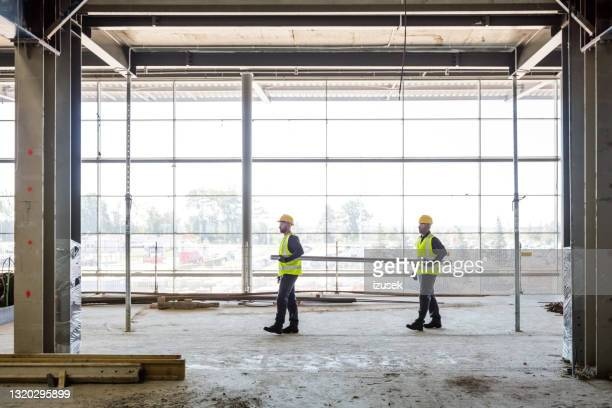 workers at construcion site - health and safety stock pictures, royalty-free photos & images