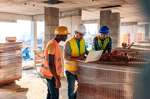 Workers at construction job site inside building 1178346537