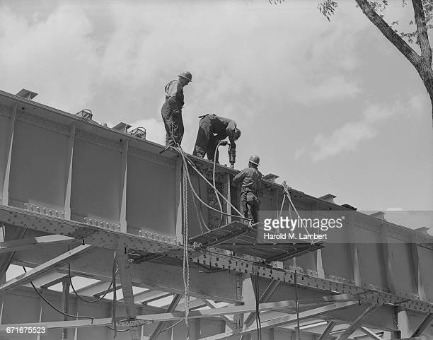 workers at construction site - number of people stock pictures, royalty-free photos & images