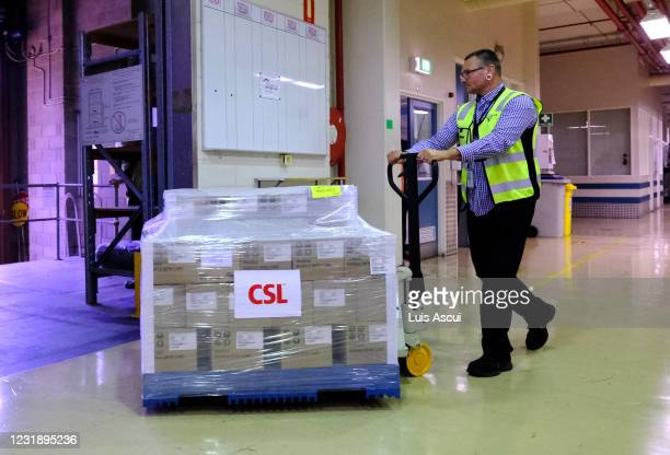 Workers at CSL roll out onto a truck the first batch of the AstraZeneca vaccine on March 24, 2021 in Melbourne, Australia. Pharmaceutical company CSL...