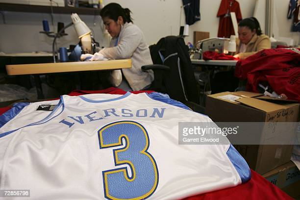 Workers at Denver Athletic sew up the official game jersey for newly acquired player Allen Iverson of the Denver Nuggets on December 20 2006 in...
