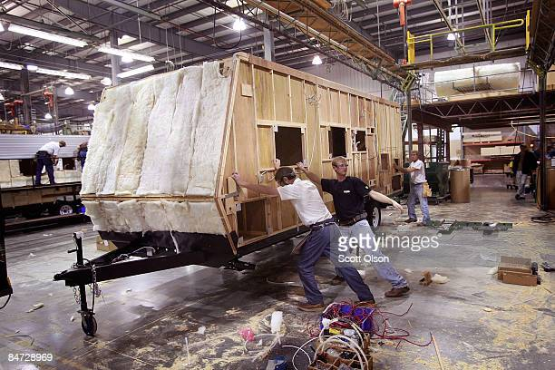 Workers at Jayco Inc the country's third largest maker of recreational vehicles move a travel trailer down the assembly line February 10 2009 in...