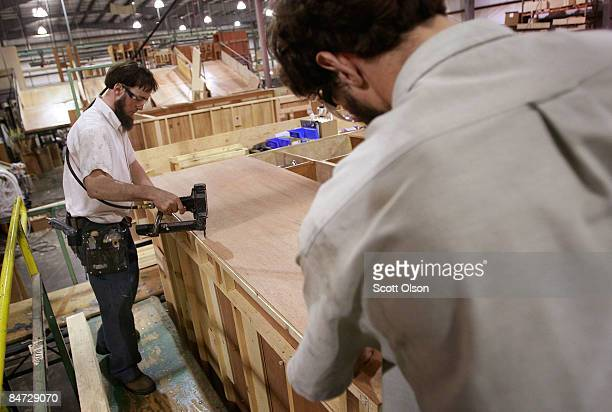 Workers at Jayco Inc the country's third largest maker of recreational vehicles put the roof on a Jay Flight travel trailer February 10 2009 in...