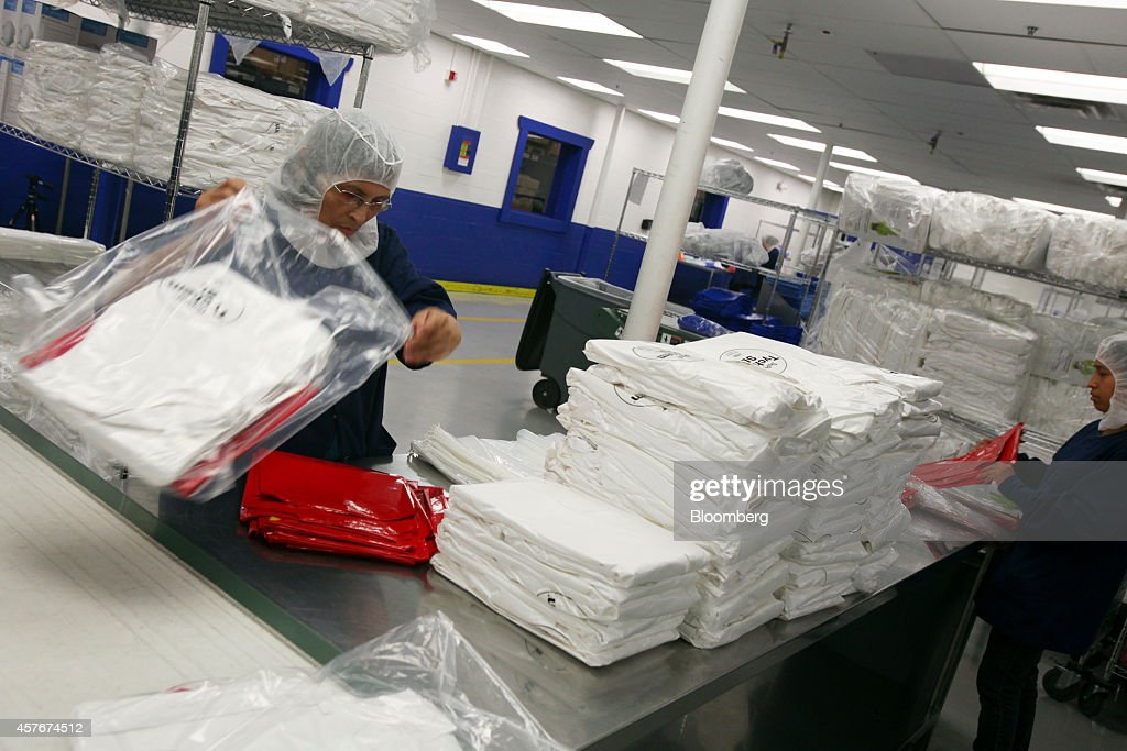 Workers at Medline Industries assemble Personal Protection Equipment