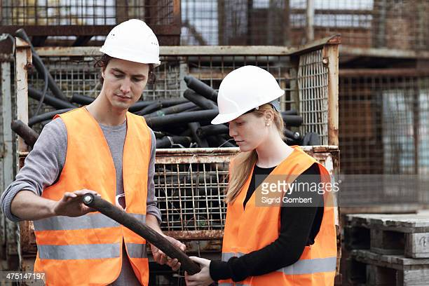workers at metal recycling plant - sigrid gombert stock pictures, royalty-free photos & images